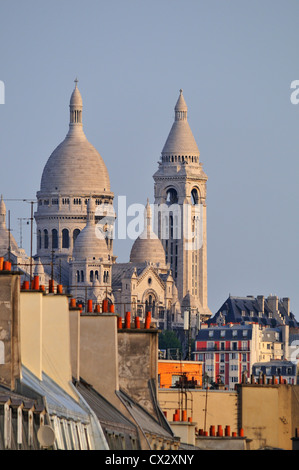 Paris, France. Sacre-Coeur and rooftops along Boulevard de Magenta - Stock Photo