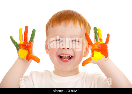 Adorable red-haired boy with hands painted in bright colors isolated on white - Stock Photo