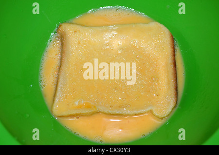 making french toast / eggy bread. - Stock Photo