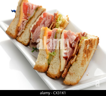 Club Sandwich With Ham And Bacon - Stock Photo