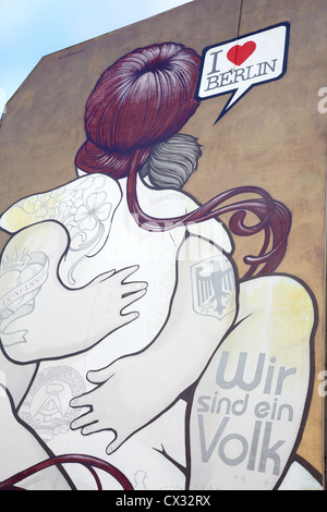 Graffiti couple on building wall near East side Gallery. I love Berlin.