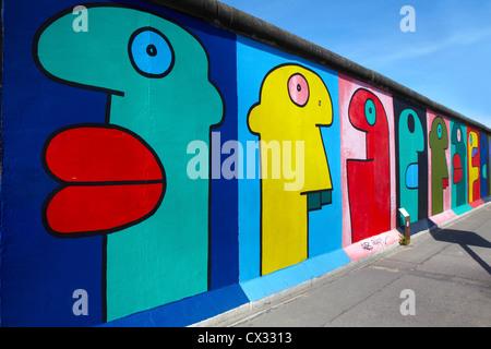East side Gallery graffiti in Berlin - Stock Photo