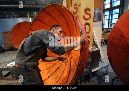 ITAR-TASS: MOSCOW, RUSSIA. DECEMBER 26, 2011. A male prop-maker making oranges for Sergei Prokofiev's opera The - Stock Photo