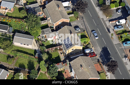 aerial view of domestic solar panels on a private house roof - Stock Photo