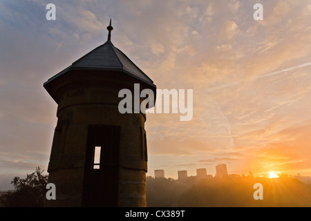 Luxembourg City - View from the old town with a spanish tower at the scyscrapers of Kirchberg at sunrise. - Stock Photo