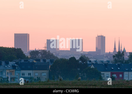 Luxembourg City - Kirchberg plateau, the towers of the Cathedral and the quarter of Cessange at sunrise. - Stock Photo