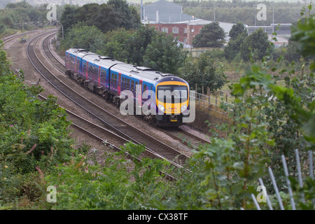 British First Trans Pennine Express train DMU 185 134 heading eastwards through Mirfield en route to Newcastle - Stock Photo
