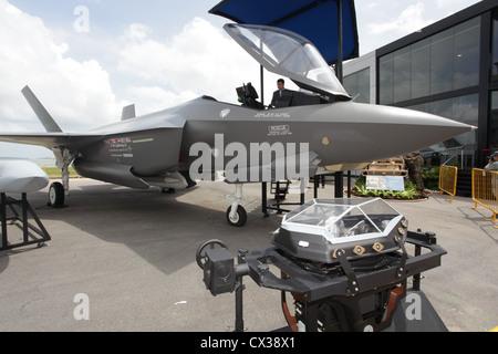 ITAR-TASS: SINGAPORE. FEBRUARY 14, 2012. A full-scale model of the Lockheed Martin F-35 Lightning II, a single-seat, - Stock Photo