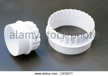Pastry cutters. White plastic cookie cutter set. - Stock Photo