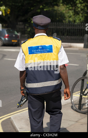 A parking control officer or traffic warden, London, England - Stock Photo
