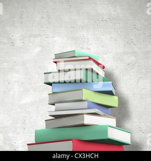 Buecherstapel aus Hardcoverbüchern mit farbigem Einband ohne Aufschrift - stack of books - Stock Photo