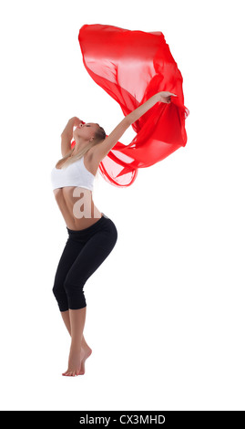 Young blond woman dance with red flying fabric isolated - Stock Photo