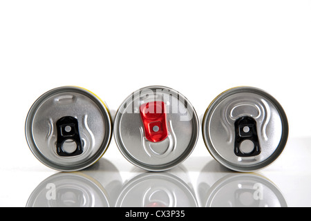 Three silver aluminum cans for drinks and their black and red rings opening - Stock Photo