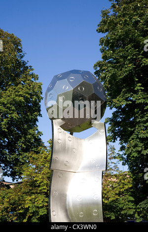Orbital sculpture by John Thomson in the South East corner of Havant park on a warm Sunday afternoon - Stock Photo