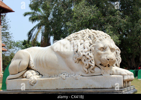 Statue or sculpture of a lion in front of Napier Museum of Art and Natural history Trivandrum Kerala India - Stock Photo