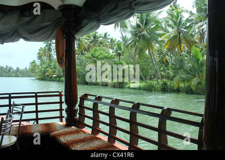 A view of banks of Astamudi Lake from inside a houseboat - Stock Photo