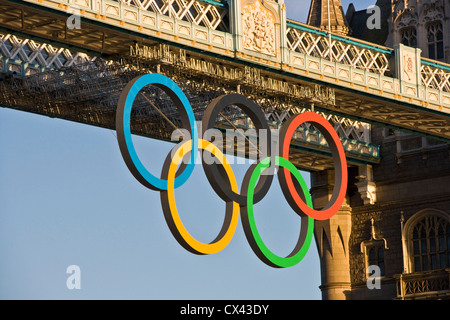 Five interlocking Olympic rings attached to grade 1 listed Tower Bridge in preparation for London 2012 Olympics - Stock Photo