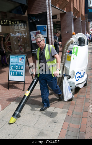 street cleaning cleaner cleaners sweep sweeping the streets public space cleaning services municipal road roadsweeper - Stock Photo