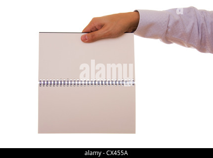 A hand holding a empty spiral note-book - Stock Photo