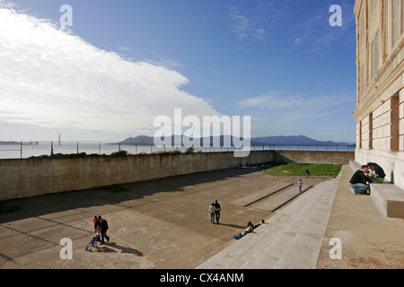 The exercise yard at Alcatraz prison, with the Golden Gate Bridge in the far distance. San Francisco Bay, California. - Stock Photo