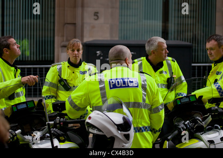 Five police officers from Strathclyde Police Force, in central Glasgow, wearing high visibility jackets - Stock Photo