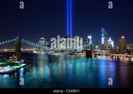 New York City Skyline with Tribute of LIght Memorial for September 11 - Stock Photo