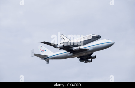 Space Shuttle Discovery's final flight to the Smithsonian Institute Udvar-Hazy museum aboard a Shuttle Carrier Aircraft - Stock Photo
