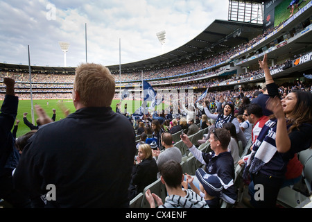 Supporters cheer on their teams during an Australian Rules football game at the MCG.  Melbourne, Victoria, AUSTRALIA