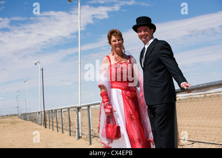 Couple in fancy dress for the fun of the Birdsville Races.  Birdsville, Queensland, AUSTRALIA. - Stock Photo