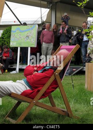 Man asleep in deck chair, Hay Literary Festival, Hay on Wye, Powys, Wales - Stock Photo