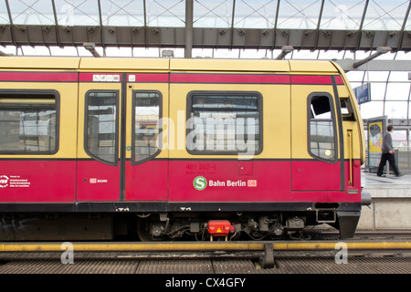 The German Railway in Berlin – Spandau an S Bahn suburban train in a German station - Stock Photo