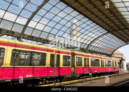 The German Railway in Berlin – Spandau an S Bahn suburban train in a German station - Stock Photo