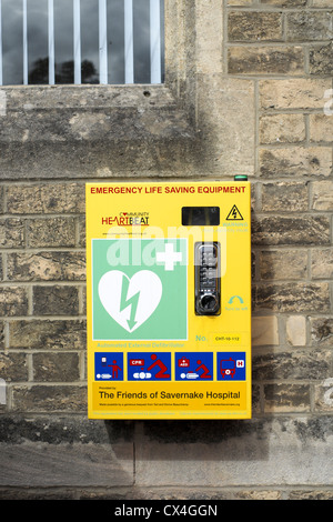 Automated external defibrillator mounted on the wall outside of Marlborough Library in Wiltshire UK - Stock Photo