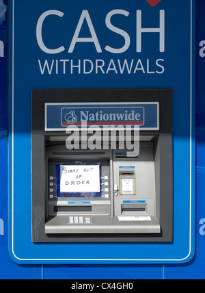 ATM cash machine with out of order sign stuck over screen - Stock Photo