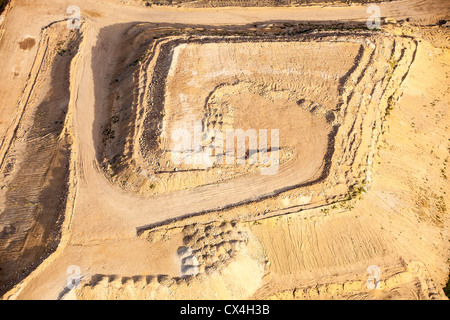 Soil overburden being removed to get at the tar sands below, in a mine north of Fort McMurray, Alberta, Canada. - Stock Photo