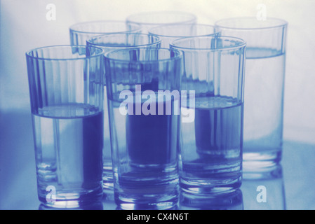 8 glasses of water - Stock Photo