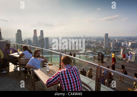 Tourists on the observation deck of the Marina Bay Sands SkyPark which sits 200 metres above the city. Marina Bay, - Stock Photo