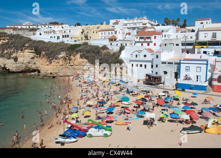 ALGARVE, PORTUGAL. A view of the town and beach at the holiday resort of Praia do Carvoeiro. 2012. - Stock Photo