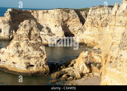 ALGARVE, PORTUGAL. A rocky cove at Marinha near Praia do Carvoeiro, with collapsed arch and stack. 2012. - Stock Photo