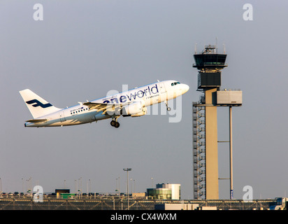 Airplane is taking off from a runway at Düsseldorf International Airport. Air traffic control tower. Düsseldorf, - Stock Photo