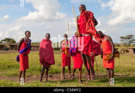 Kenya Masai Mara Masai warriors doing traditional jumping for tourists in Masai Mara National Park in reserve #9 - Stock Photo