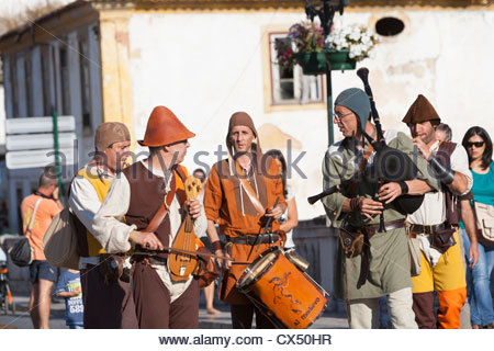 Men playing instruments dressed in medieval costume. Tomar Central Portugal - Stock Photo