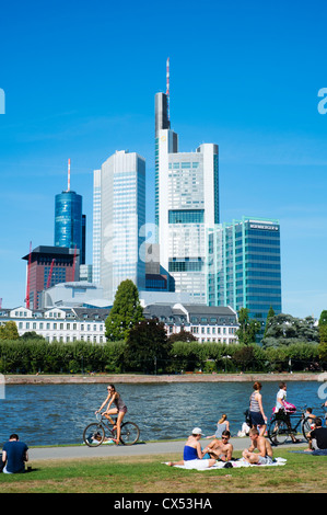 Skyline of financial district in city of Frankfurt on River Main in Hesse Germany - Stock Photo