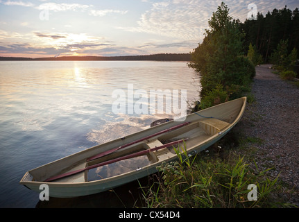 Morning landscape with old row boat on the coast of Saimaa lake, Finland - Stock Photo