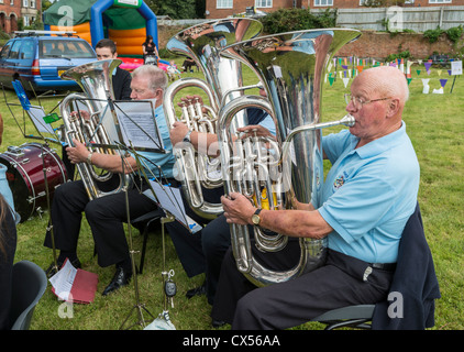 LYDNEY TRAINING BAND TUBA PLAYERS PLAYING AT CHURCH FETE IN LYDNEY GLOUCESTERSHIRE ENGLAND - Stock Photo