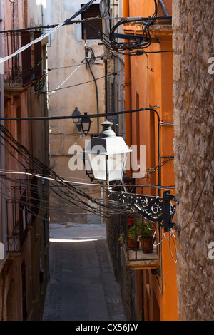 Small alley in a authentic village in Catalonia, Spain - Stock Photo