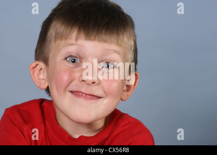 Little boy has big blue eyes and big grin. - Stock Photo