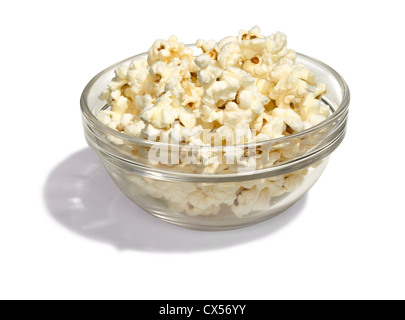 bowl of popcorn in a glass bowl on a white background - Stock Photo
