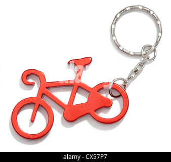 red bike key chain photographed on a white background - Stock Photo