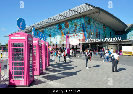 UK Telephone boxes painted Olympic pink & adapted as information points for London 2012 games on the forecourt of - Stock Photo